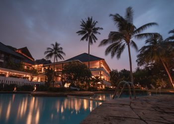 Queenslander home with evening lighting reflecting on pool